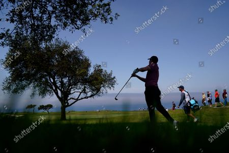 Matt Fitzpatrick, of England, hits from the rough along the fifth fairway during the first round of the U.S. Open Golf Championship, at Torrey Pines Golf Course in San Diego