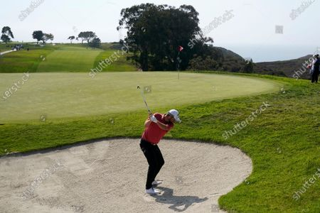 Marc Leishman, of Australia, plays a shot from a bunker on the 13th hole during the first round of the U.S. Open Golf Championship, at Torrey Pines Golf Course in San Diego