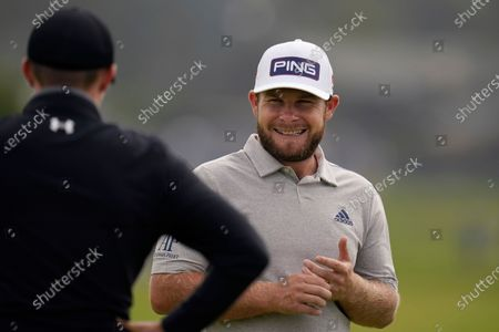Tyrrell Hatton, right, laughs with Matt Fitzpatrick, of England, on the first green during the first round of the U.S. Open Golf Championship, at Torrey Pines Golf Course in San Diego