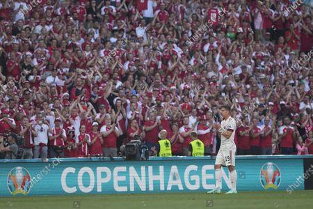 Belgium's Leander Dendoncker applauds as the Belgium team pays tribute to Denmark's Christian Eriksen in 10th minute during the Euro 2020 soccer championship group B match between Denmark and Belgium at Parken stadium in Copenhagen, Denmark
