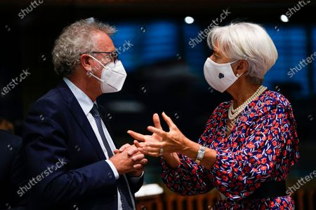 European Central Bank (ECB) President Christine Lagarde (R) talks to Luxembourg's Finance Minister Pierre Gramegna during a meeting of Eurogroup Finance Ministers at the European Council building in Luxembourg, 17 June 2021.