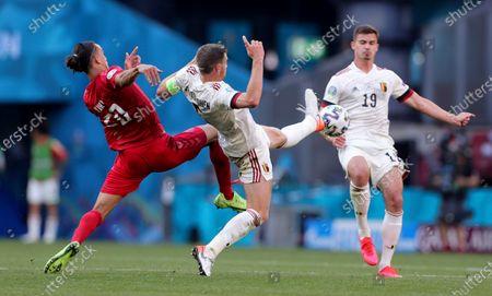 Belgium's Leander Dendoncker, right, watches as Denmark's Yussuf Poulsen, left, and Belgium's Jan Vertonghen challenge for the ball during the Euro 2020 soccer championship group B match between Denmark and Belgium at Parken stadium in Copenhagen