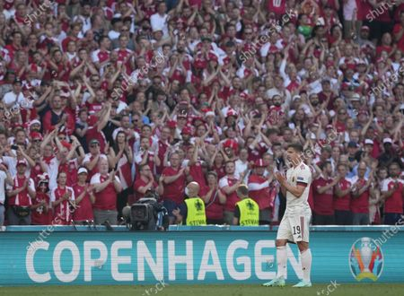 Stock Picture of Leander Dendoncker of Belgium and supportes pay tribute to Christian Eriksen of Denmark with a minute's applause during the UEFA EURO 2020 group B preliminary round soccer match between Denmark and Belgium in Copenhagen, Denmark, 17 June 2021.