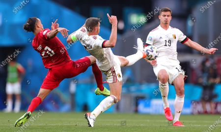 Yussuf Poulsen (L) of Denmark in action against Belgian players Jan Vertonghen (C) and Leander Dendoncker (R) during the UEFA EURO 2020 group B preliminary round soccer match between Denmark and Belgium in Copenhagen, Denmark, 17 June 2021.