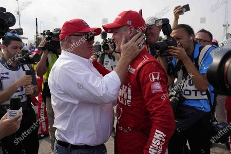 Marcus Ericsson, right, of Sweden, celebrates with team owner Chip Ganassi after winning the first race of the IndyCar Detroit Grand Prix auto racing doubleheader on Belle Isle in Detroit