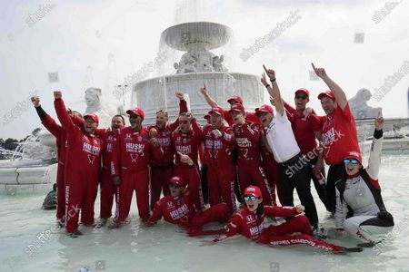 Marcus Ericsson, of Sweden, and the team celebrate winning the first race of the IndyCar Detroit Grand Prix auto racing doubleheader on Belle Isle in Detroit