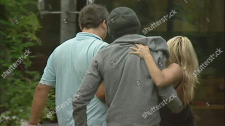 Dave Vaughan and John James Parton carry Keeley Johnson after she seems to have hurt her ankle