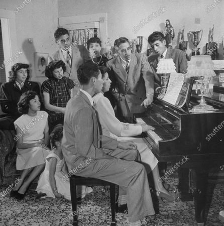 Richard Alonzo (Poncho) Gonzalez with family & friends singing and playing the piano.