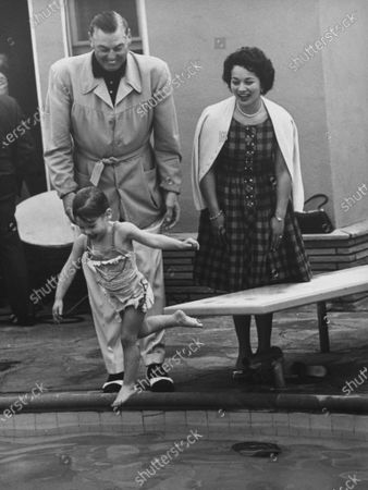 Stock Image of 2 year old, Mary Frances Crosby, daughter of Bing Crosby, as she won her Red Cross Merit Badge for beginner swimmers.