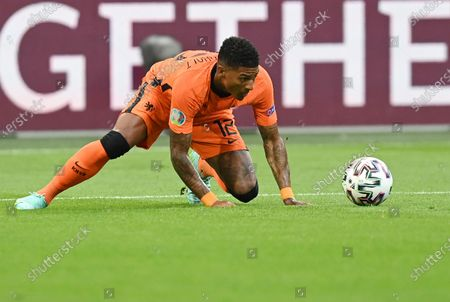 Patrick van Aanholt of the Netherlands controls the ball during the Euro 2020 soccer championship group C match between the The Netherlands and Austria at Johan Cruijff ArenA in Amsterdam, Netherlands