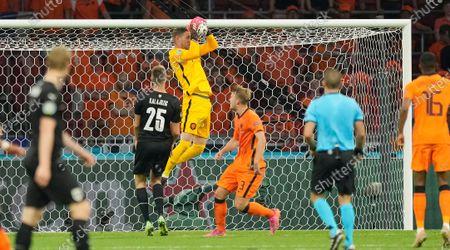 Netherlands' goalkeeper Maarten Stekelenburg, top, saves during the Euro 2020 soccer championship group C match between the The Netherlands and Austria at Johan Cruijff ArenA in Amsterdam, Netherlands