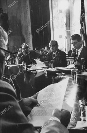 Members of the Senate Labor Rackets Committee Sen. Barry M. Goldwater (L) and Sen. John L. McClellan (C) attending a hearing on the activities of the Teamster Union with counsel to the committee Robert F. Kennedy (R).