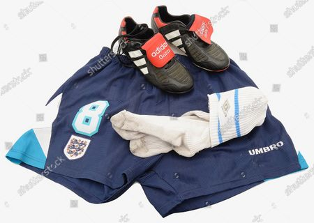 Paul Gascoigne's shorts, socks and boots from Euro 96 have sold for £5,000 following a bidding war as football fever grips the nation.  The England footballer wore the unwashed blue Umbro shorts and white socks in the classic 4-1 win over Holland at Wembley.  They were auctioned off alongside his Adidas Predator boots with 'Gazza' embroidered on the tongue which were in his kitbag that day.  England went on to lose the semi final of the tournament against Germany after current manager Gareth Southgate missed a penalty in the shootout.