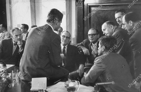 Committee counsel Robert F. Kennedy (C, back to camera) conferring with the Senators (L-R) Barry M. Goldwater, John L. McClellan, Joseph R. McCarthy, and John F. Kennedy at a Senate Labor Hearings.