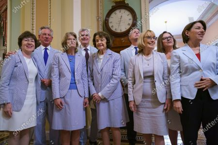 Stock Picture of With most COVID-19 restrictions lifted on Capitol Hill, Senators and staff participate in the venerable tradition of wearing seersucker suits on special days during the summer, in Washington, . From left to right are: Sen. Susan Collins, R-Maine, Sen. Tommy Tuberville, R-Ala., Sen. Lisa Murkowski, R-Alaska, Sen. Bill Cassidy, R-La., Sen. Dianne Feinstein, D-Calif., Sen. Roger Marshall, R-Kan., Sen. Maggie Hassan, D-N.H., Sen. Deb Fischer, R-Neb., and Sen. Amy Klobuchar, D-Minn