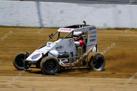 Jeff Gordon, a five-time winner of the Brickyard 400 and four-time NASCAR Cup Series champion, drives through a turn in a USAC midget car during an exhibition on the dirt track in the infield at Indianapolis Motor Speedway in Indianapolis