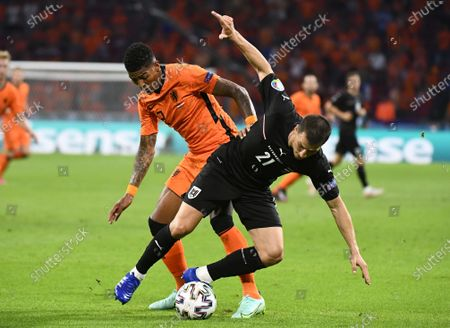 Patrick van Aanholt (L) of the Netherlands in action against Stefan Lainer of Austria during the UEFA EURO 2020 preliminary round group C soccer match between the Netherlands and Austria in Amsterdam, Netherlands, 17 June 2021.