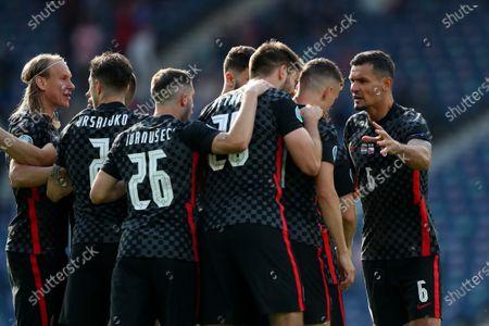 Stock Photo of Ivan Perisic of Croatia celebrates scoring his side's equalising goal with team mates to make the score 1-1