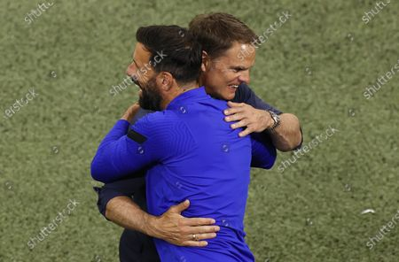 Stock Image of Netherlands head coach Frank de Boer (R) and his assistant Ruud van Nistelrooy (L) celebrate after winning the UEFA EURO 2020 preliminary round group C soccer match between the Netherlands and Austria in Amsterdam, Netherlands, 17 June 2021.
