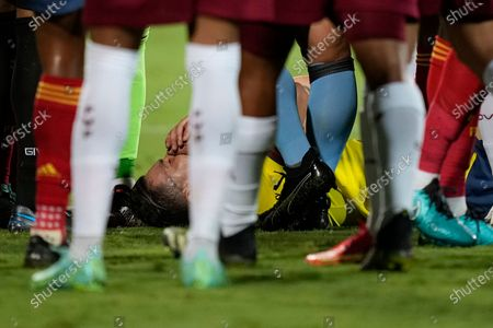 Colombia's Mateus Uribe lies on the ground during a Copa America soccer match against Venezuela at the Olimpico stadium in Goiania, Brazil