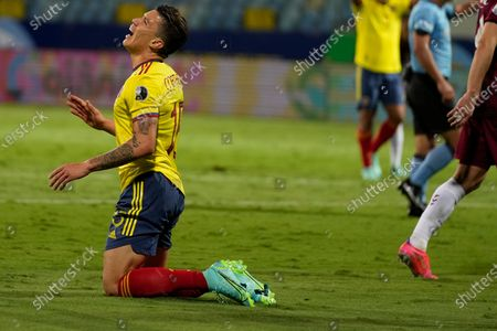 Colombia's Mateus Uribe reacts after missing a chance to score against Venezuela during a Copa America soccer match at the Olimpico stadium in Goiania, Brazil