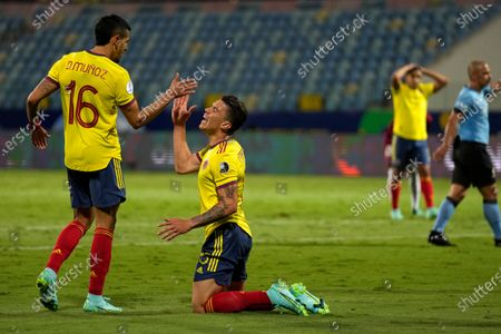 Colombia's Mateus Uribe, center, reacts after missing a chance to score against Venezuela during a Copa America soccer match at the Olimpico stadium in Goiania, Brazil