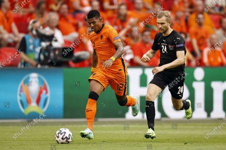 Patrick van Aanholt (L) of the Netherlands in action against Konrad Laimer of Austria during the UEFA EURO 2020 preliminary round group C soccer match between the Netherlands and Austria in Amsterdam, Netherlands, 17 June 2021.