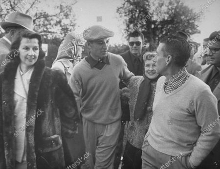 Golfer Ben Hogan (C) and his wife (L), waking with songwriter Hoagy Carmichael (R).