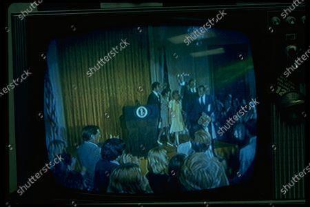 TV image of (L-R) David Eisenhower, Julie Nixon Eisenhower, Patricia Nixon Cox, Pres. & Mrs. Nixon leaving dais after farewell speech to staff.
