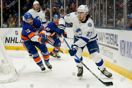 Stock Image of Tampa Bay Lightning defenseman Ryan McDonagh (27) looks to pass as New York Islanders center Mathew Barzal (13) defends during the second period of Game 3 of the NHL hockey Stanley Cup semifinals, in Uniondale, N.Y