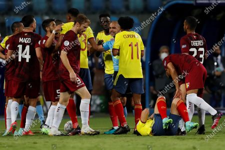 Stock Photo of Colombia's and Venezuela's players argue with Paraguayan referee Eber Aquino, during the Copa America group B soccer match between Colombia and Venezuela at the Pedro Ludovico Teixeira Olympic Stadium, in Goiania, Brazil, 17 June 2021.