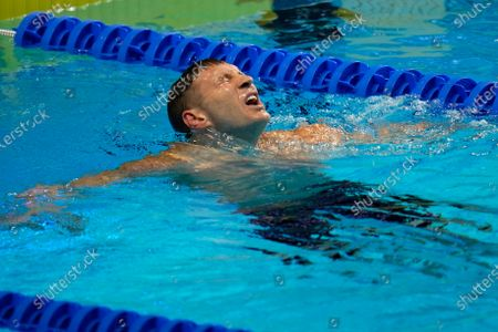 Ryan Murphy reacts after winning his heat in the men's 200 backstroke during wave 2 of the U.S. Olympic Swim Trials, in Omaha, Neb