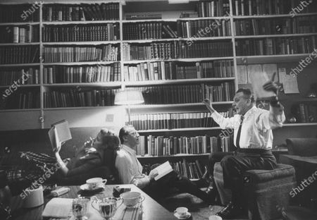 Librettist Alan Jay Lerner of My Fair Lady (L) and his wife Nancy Olson, with composer Frederick Loewe in library.