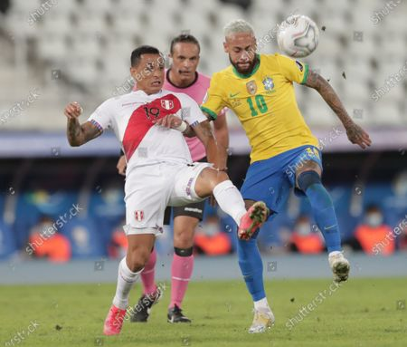 Brazil's Neymar (R) in action against Peru's Yoshimar Yotun (L) during the Copa America group A soccer match between Brazil and Peru at the Nilton Santos Olympic Stadium in Rio de Janeiro, Brazil, 17 June 2021.