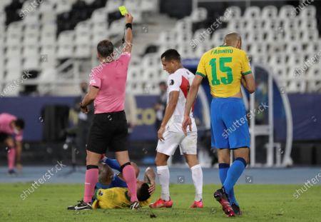 Argentine referee Patricio Loustau (L) shows yellow card to Peru's Yoshimar Yotun (C), during the Copa America group A soccer match between Brazil and Peru at the Nilton Santos Olympic Stadium in Rio de Janeiro, Brazil, 17 June 2021.