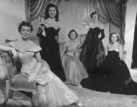 November 1950: Movie starlets (L-R) Phyllis Kirk, Debra Paget, Debbie Reynolds, Jean Hagen, and Nancy Olson in evening dress.