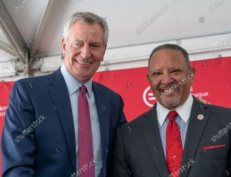Mayor Bill de Blasio and Marc Morial attend construction kickoff for National Urban League Empowerment Center in Harlem. New center will include Urban Civil Rights Museum, NAL Headquarters, National Urban League Institute for Race, Equity and Justice, 170 units of affordable housing, office space for non-profits organizations including One Hundred Black Men of New York, United Negro College Fund and Jazzmobile, and retail space with Target and Trader Joe's as anchors.