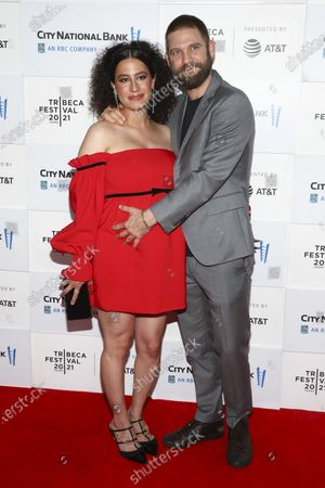 """Actress Ilana Glazer, left, and husband David Rooklin, right, attend the premiere for """"False Positive"""" during the 20th Tribeca Festival at The Waterfront Plaza at Brookfield Place, in New York"""