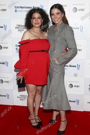"""Actresses Ilana Glazer, left, and Sophia Bush, right, attend the premiere for """"False Positive"""" during the 20th Tribeca Festival at The Waterfront Plaza at Brookfield Place, in New York"""