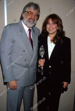 Married producers Harry Thomason and Linda Bloodworth- Thomason (holding their award).