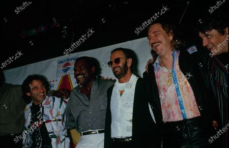 UNITED STATES - 20th June 1989:  Ringo Starr with Clarence Clemons, Nils Lofgren, Billy Preston, Joe Walsh and Rick Danko  . Announcing the 'Concert For All Generations'.