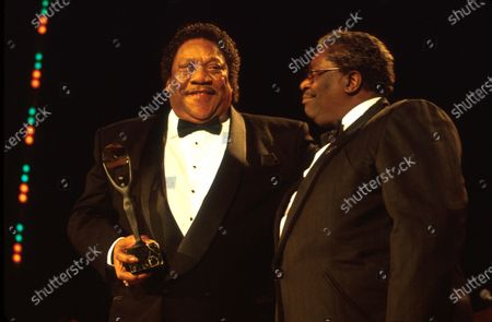 Stock Picture of (L-R) Musicians Bobby Blue Bland (holding award) and B.B. King.
