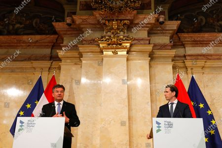 Miroslav Lajcak, EU Special Representative for the Belgrade- Pristina Dialogue, left, attends a news conference with Austria's Chancellor Sebastian Kurz, and talks about the results of a Western Balkans conference in Vienna, Austria