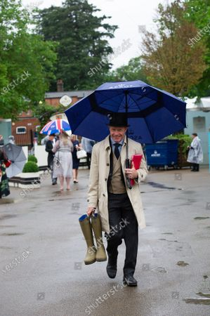 Stock Photo of ITV's Mick Fitzgerald arrives with his wellies. Torrential rain fell in Ascot this morning as racegoers arrived for Day Four of Royal Ascot
