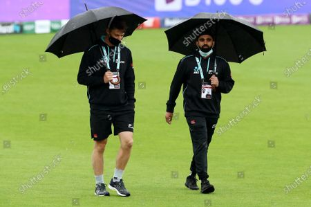 Will Young and Ajaz Patel of New Zealand are seen during the lunch break.