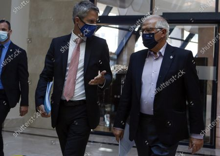 Josep Borell, right, European Union's High Representative for Foreign Affairs and Security Policy, walks for a meeting with Iran's Foreign Minister Javad Zarif, on the sidelines of a diplomatic forum in Antalya, Turkey