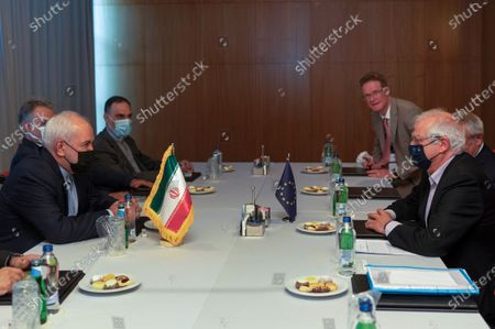 Stock Image of Heading their respective delegations, Josep Borell, right, European Union's High Representative for Foreign Affairs and Security Policy, Iran's Foreign Minister Javad Zarif, left, meet on the sidelines of a diplomatic forum in Antalya, Turkey