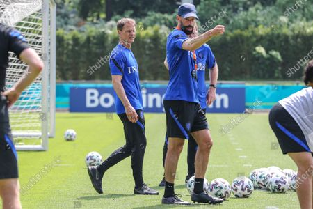 Dutch head coach Frank de Boer (L) and assistant coach Ruud van Nistelrooy (R) during a training session of the Dutch UEFA EURO 2020 national team on the KNVB Campus in Zeist, the Netherlands, 18 June 2021.