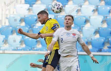 Marcus Berg (L) of Sweden in action against Peter Pekarik of Slovakia during the UEFA EURO 2020 group E preliminary round soccer match between Sweden and Slovakia in St.Petersburg, Russia, 18 June 2021.