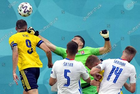 Marcus Berg (L) of Sweden in action against Slovakia's goalkeeper Martin Dubravka (back C) during the UEFA EURO 2020 group E preliminary round soccer match between Sweden and Slovakia in St.Petersburg, Russia, 18 June 2021.